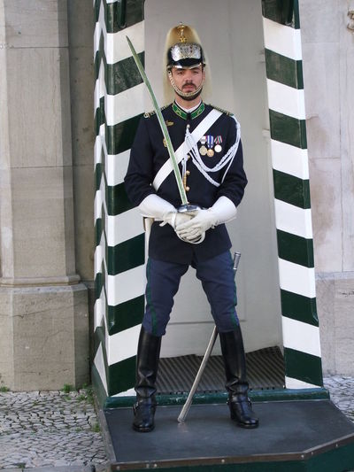 Portuguese Guard Capital City City Composition Costume Front View Full Frame Full Length Guard Helmet Lifestyles Lisbon Looking At Camera No Incidental People Outdoor Photography Portrait Portugal Soldier Sword And Scabbard Tourism Tourist Destination Uniform White And Blue Colour