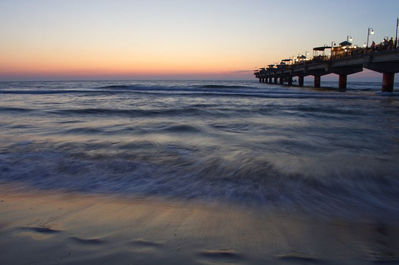 Coast Baltic Sea Polish Sea Poland Pier EyeEm Selects Sky Sunset Sea Water Beach Land Horizon Over Water Horizon Beauty In Nature Scenics - Nature Nature Orange Color Silhouette Tranquil Scene Outdoors Wave Motion Leisure Activity