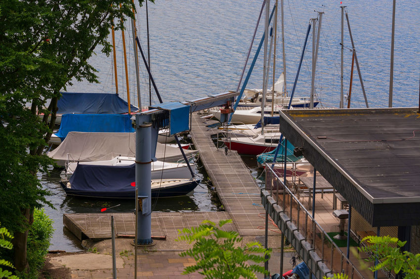 Essen in Germany, panoramic view from Baldeney Lake (Baldeneysee) Ruhrgebiet Architecture Baldeneysee Blue Boat Built Structure Day Mast Moored Nature Nautical Vessel No People Outdoors Reservoir Transportation Tree Water