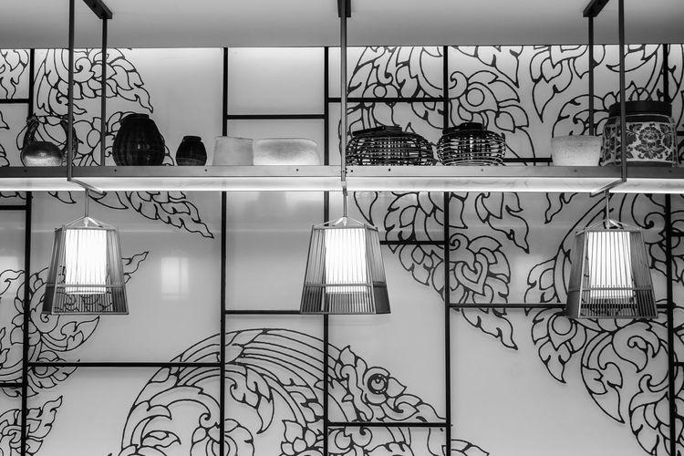 Graffiti on wall seen through glass window at home