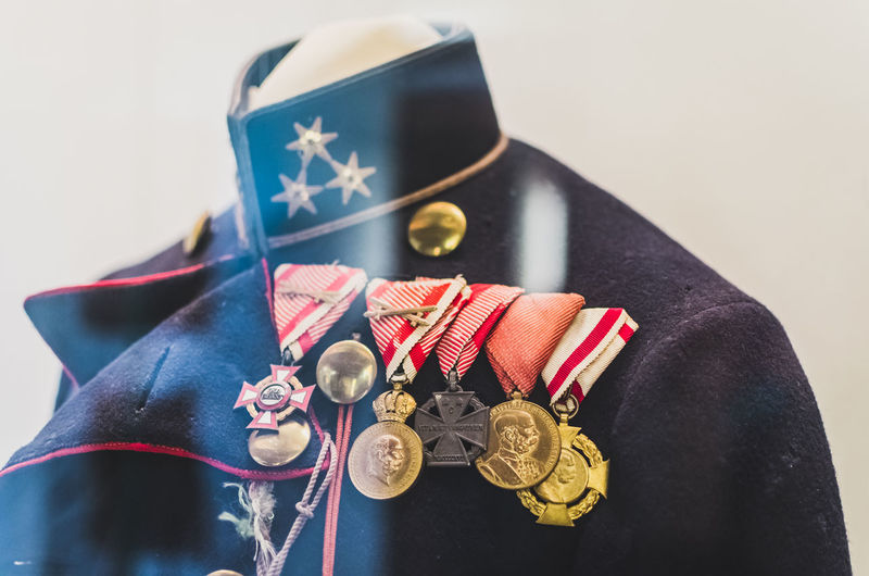Close-Up Of Medals On Military Uniform Seen Through Glass Window