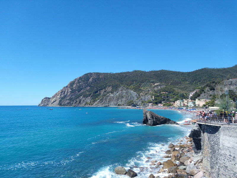 Monterosso, Fegina beach Cinque Terre Hills Liguria, Italy Trees Beach Beauty In Nature Blue Clear Sky Day Different Shades Of Blue Horizon Horizon Over Water Mountain Nature Rock Scenics - Nature Sea Seafront Sky Tranquil Scene Tranquility Village On The Sea Water Waves Crashing