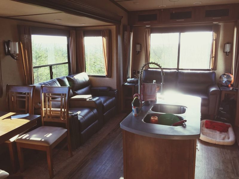 Trailer Life Sunset Fifth Wheel Trailer Indoors  Window Table Domestic Room Sofa Day Living Room No People Furniture Domestic Kitchen
