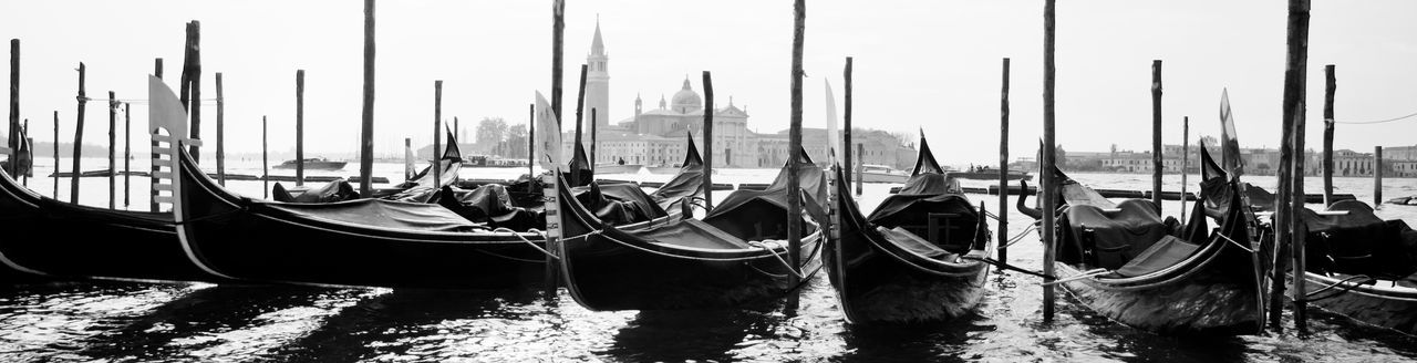 Gondola - Traditional Boat Transportation Water Moored Mode Of Transportation Travel Destinations No People Canal Tourism Wooden Post Lagoon Travel Day Venice, Italy Mediterranean Sea Tourist Attraction  Historical Building