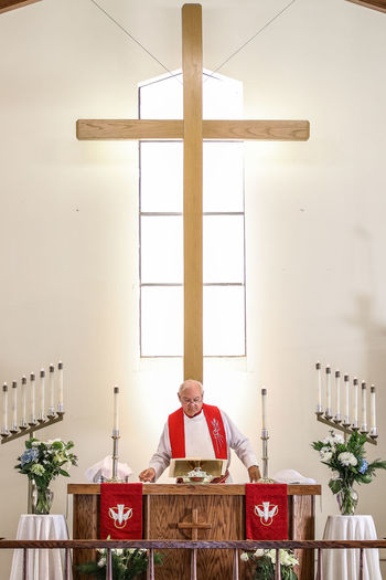 Priest Standing In Church