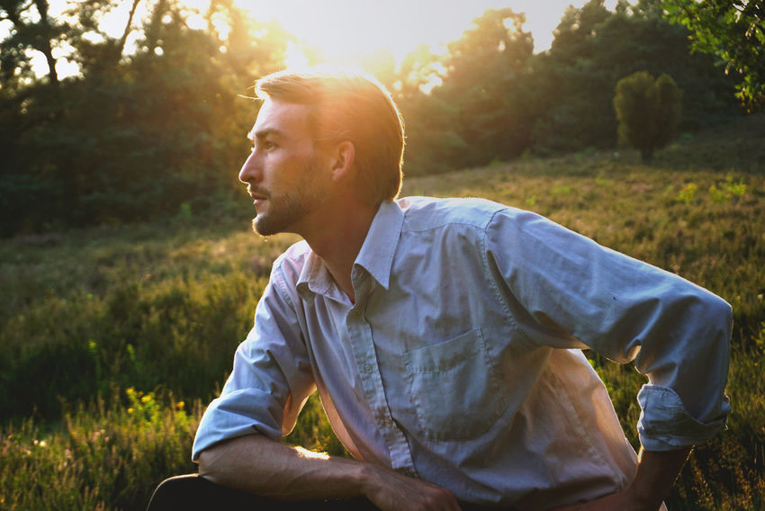 Adult Adults Only Beard Casual Clothing Day Focus On Foreground Grass Leisure Activity Lifestyles Men Mid Adult Mid Adult Men Nature One Man Only One Person Outdoors People Real People Relaxation Sitting Sunlight Sunset Tree Young Adult Young Men