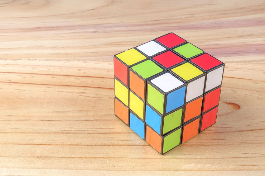 RUBIK'S CUBE , CREATIVITY TOY Creativity Rubik Cube Block Block Shape Circle Close-up Cube Shape Design Flooring Geometric Shape High Angle View Indoors  Intelligence Multi Colored No People Pattern Puzzle  Rubik Shape Still Life Table Toy Toy Block Wood - Material Wood Grain