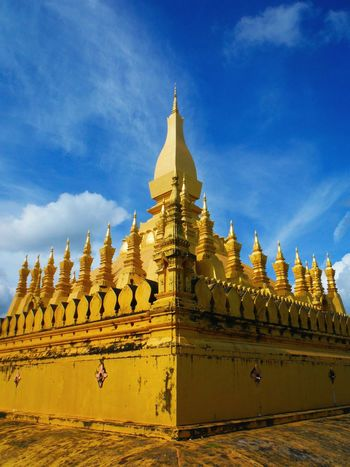 Gold Colored Gold That Luang Stupa Pha That Luang Phathatluang Laos Temple Thatluangtemple Laos Travel Pha That Luang Laos That Luang Vientiane Vientiane Laos Vientiane, Laos Temple Architecture Tourist Destination Travel Destinations Stupa Golden Temple Gold Temple Pagoda Sky Architecture Tourism Explore Laos Travel Laos