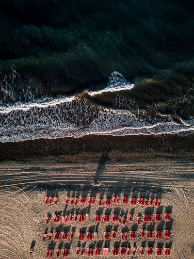 Nature Land Beauty In Nature No People Scenics - Nature Motion Water Red Plant High Angle View Day Outdoors Tranquility Sunlight Sea Landscape Tranquil Scene Non-urban Scene Field Beach Shadow Ocean Wave Beach Chairs