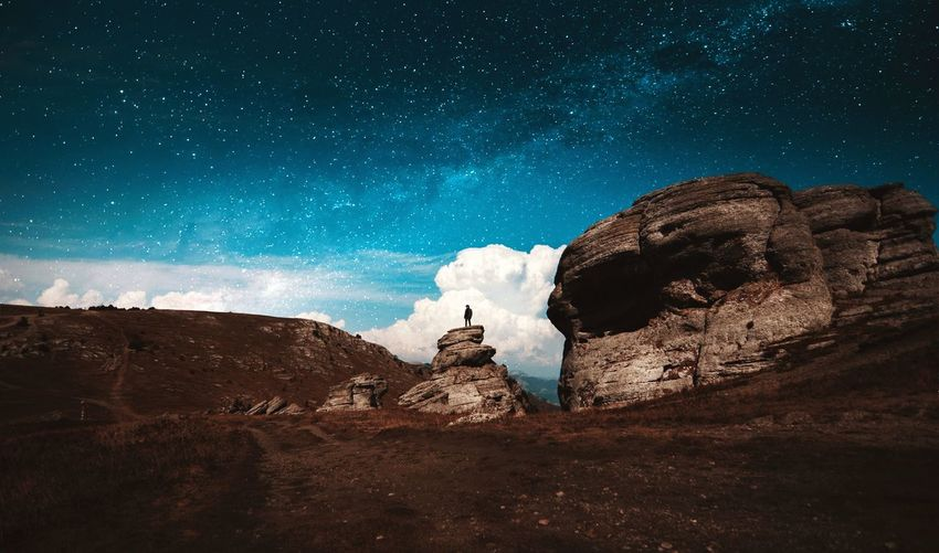 Rock formations against star field