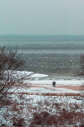 Couple Love Relationship Romantic Adult Adults Only Beach Beauty In Nature Cold Temperature Day Full Length Horizon Over Water Leisure Activity Nature Outdoors People Scenics Sea Sky Snow Sport Tranquility Vacations Water Winter