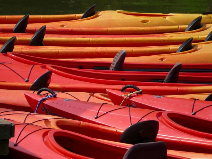 Abundance Canoes Leisure Activity Multi Colored On The River Bank  Outdoors Red Yellow Orange Repetition Side By Side Color Palette Colors And Patterns