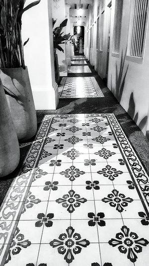 Peranakan-style tiling on the corridor of an old builidng. Peranakan refers to Straits-born Chinese that are the descendants of Chinese immigrants who came to British Malaya and Dutch East Indies. Taking Photos Check This Out Hello World Architecture Old And Beautiful Old And New Old Buildings Night Photography Nightphotography Streetphotography Street Photography Black & White Black And White Noir Noiretblanc Noir Et Blanc Black&white Light And Dark Light And Shadows Light And Shadow not the First Eyeem Photo Showcase: January Pattern Pieces