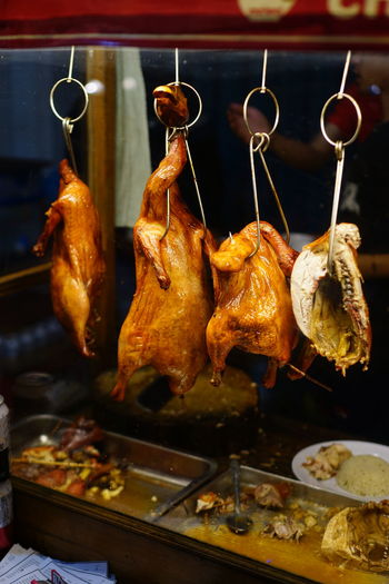 Close-up of roasted meat hanging on barbecue grill