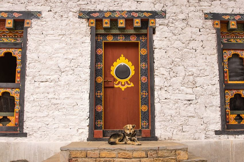 Guardsman Buddhism Temple Town Bhutan Himalayas ASIA Travel EyeEm Selects Architecture No People Built Structure Building Exterior Art And Craft Wall - Building Feature Day Gold Colored Decoration Building Craft Entrance Creativity History