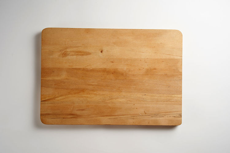 High angle view of wood on table against white background