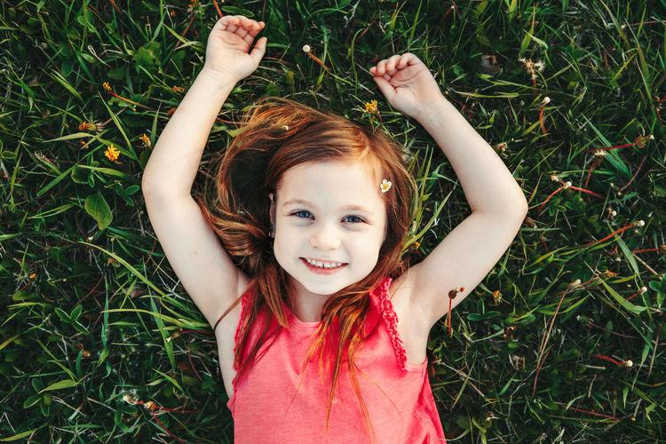 Portrait of smiling girl on field
