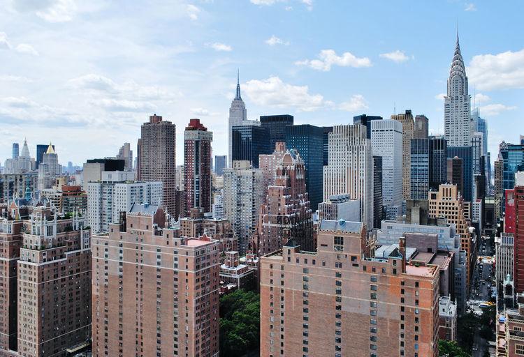 Chrysler building against sky in city