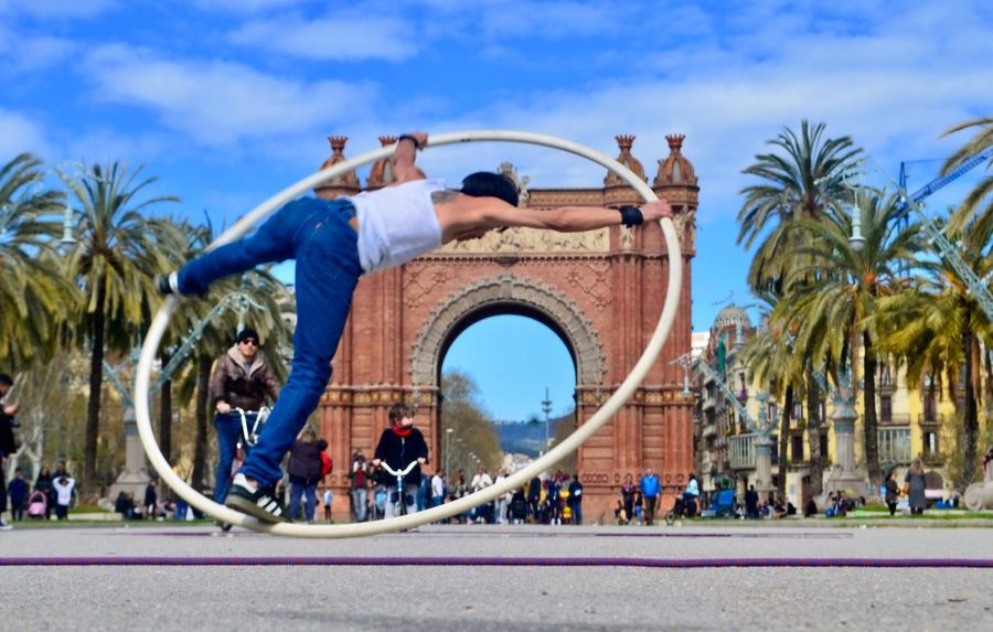 Arc De Triomf Barcelona Streetphotography Eye4photography  EyeEm Gallery Palm Tree Day Sky Outdoors Tree Blue Real People Leisure Activity Built Structure Lifestyles Young Adult Architecture
