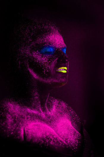 Portrait Make-up Human Body Part Looking At Camera One Person Dark Adult Fashion Human Face Women Beauty Beautiful Woman Stage Make-up Face Paint Headshot Body Part Purple Young Adult Indoors  Body Paint Neon Colored Human Lips