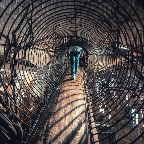 My son climbing at City Museum in St Louis Leisure Activity Iron Metal Perspective Exercise Built Structure Exploring City Museum Stlouis Light And Shadow Tunnel Tunnel Vision Exploring New Ground Alternative Fitness Exercising Walking One Person The Architect - 2016 EyeEm Awards Original Experiences Feel The Journey On The Way Adventure Club