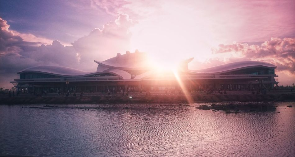 sunset on new airport tjilik riwut Sunset Water Cityscape Sky Architecture Cloud - Sky Built Structure Dramatic Sky