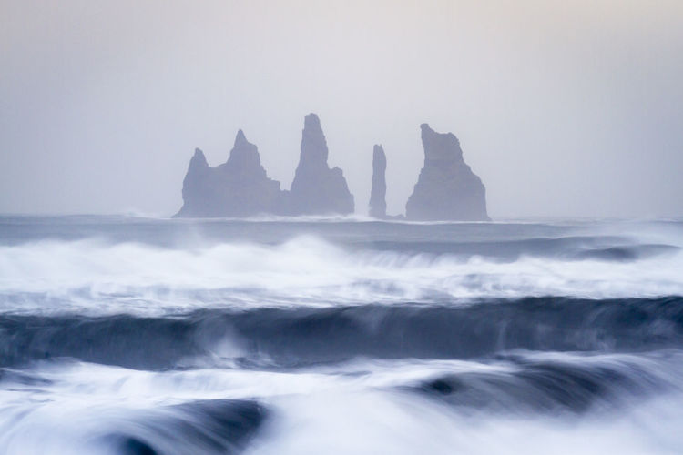 Reynisdrangar – Vik, hour vith iconic sea iconic place. Blue Hour Dyrhólaey EyeEmNewHere Iceland Long Exposure Shot Wave Artistic Photo Artistic Photography Beauty In Nature Blue Hour Landscape Iconic Landscape Long Exposure Motion Nature Ocean Outdoors Reynisdrangar Scenic View Scenics - Nature Sea Sky Travel Destinations Vik Water