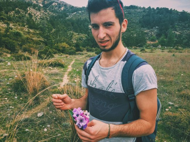 Friend picking up flowers for his girlfriend Mountains Trip Erasmus Flower Cute Erasmus Photo Diary