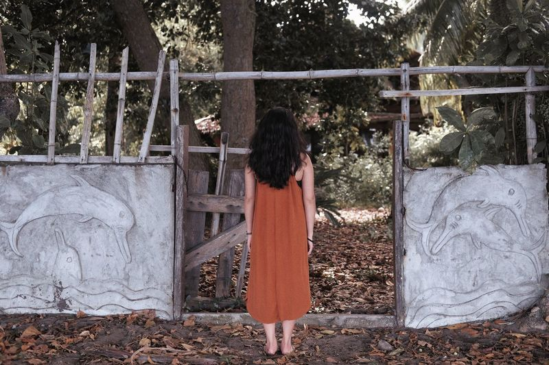Rear view of beautiful woman on an abandoned space neutral colors