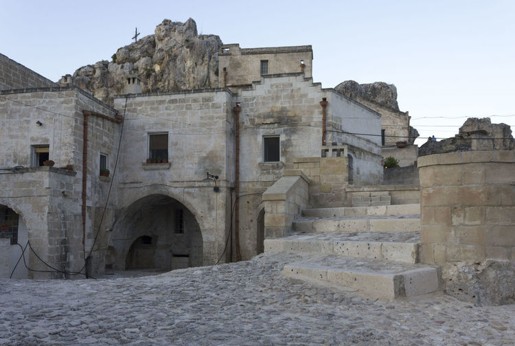 Matera Italy Basilicata South Italy Nobody UNESCO World Heritage Site Grotto Cave Architecture Built Structure History The Past Building Exterior Sky Ancient Old Clear Sky Old Ruin Ancient Civilization Travel Destinations Travel Day Building Nature Tourism No People Arch Abandoned Outdoors Archaeology Deterioration Ruined