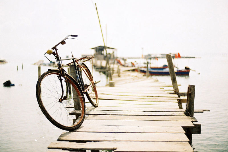 A bicycle at the jetty in Penang, Malaysia. Bicycle Bridge Clear Sky Film Photography Jetty Leica M6 Image Leica M6 Photo Leica M6 Ttl Malaysia No People Outdoors Penang People Transportation Water