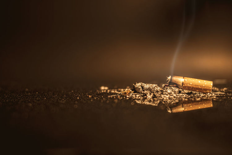Close-up of cigarette against black background
