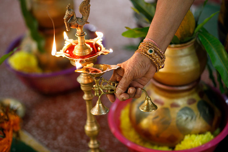 Cropped Hand Of Woman Lightning Oil Lamp