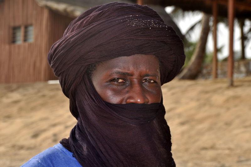 Close-up portrait of man wearing headscarf