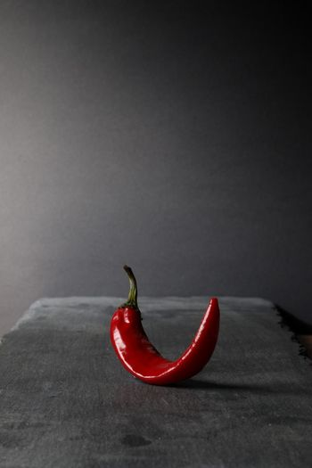 Close-up of red chili pepper against black background