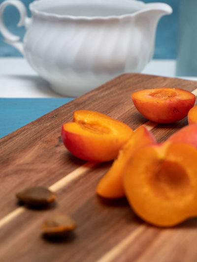 Close-up of orange slices on cutting board