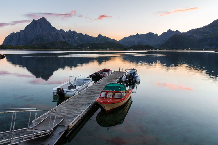 Amazing landscape from Lofoten - Norway Norway Reflection Beauty In Nature Boat Day High Angle View Lake Lofoten Mode Of Transport Moored Mountain Mountain Range Nature Nautical Vessel No People Outdoors Reflection Scenics Sky Sunrise Sunset Tranquility Transportation Tree Water