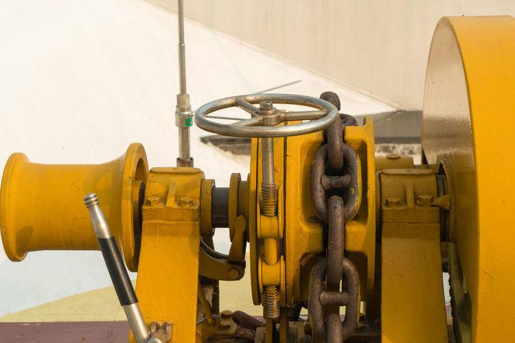 Yellow machine part in factory