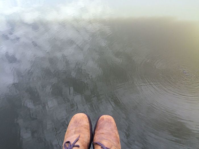 High angle view of person standing in water
