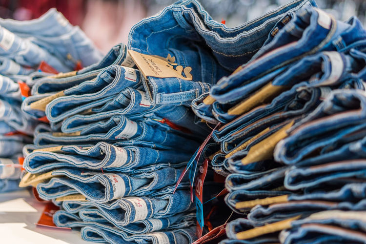 Close up of stacked jeans in store