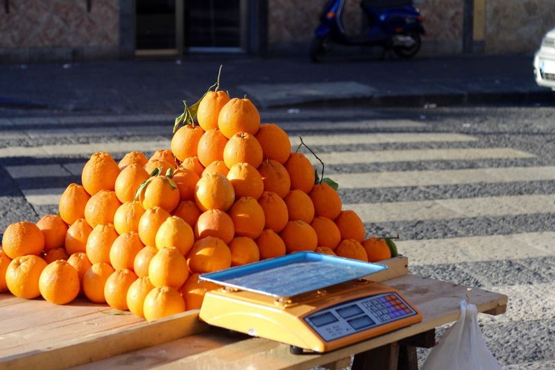 Stack of mandarin oranges for sale at street