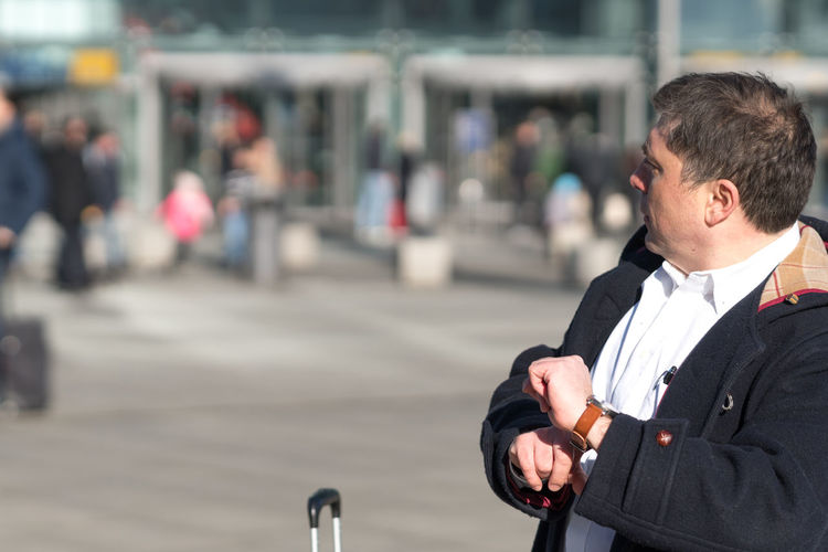 Businessman Waiting While Standing In City
