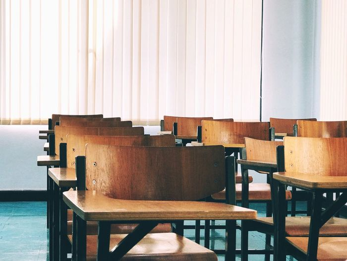 Empty Chairs With Desk In Classroom