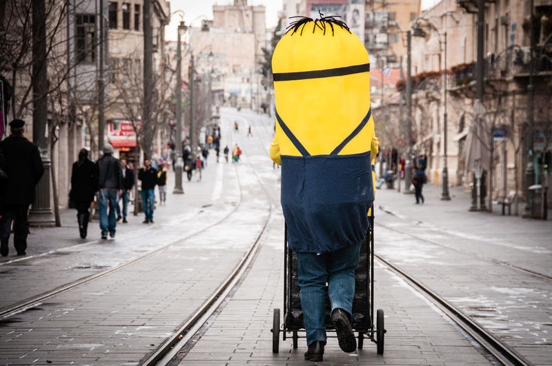 City City Life Composition Costume Fun Funny Israel Jerusalem Leading Lifestyles Men Minion  Minions People People Watching Rails Standing Street Street Photography Streetphotography Train Tracks Urban Urban Lifestyle Walking Yellow Mobility In Mega Cities