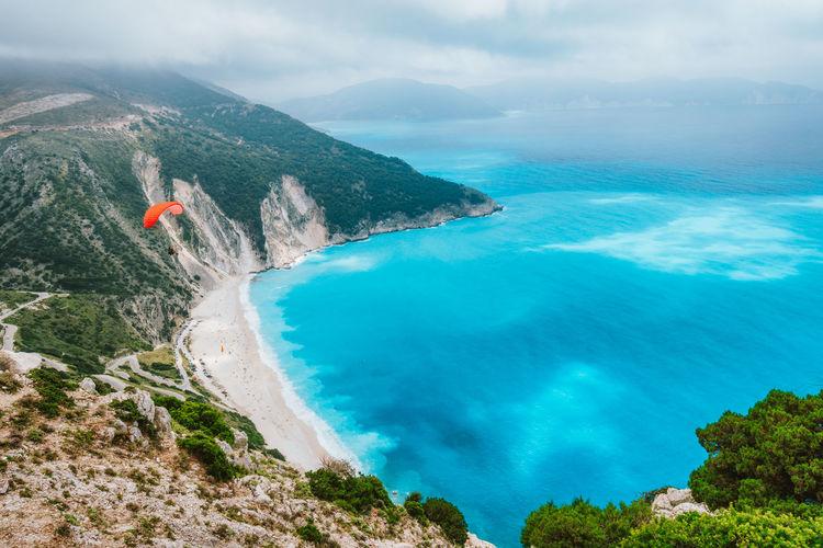 Idyllic shot rocky cliff by sea