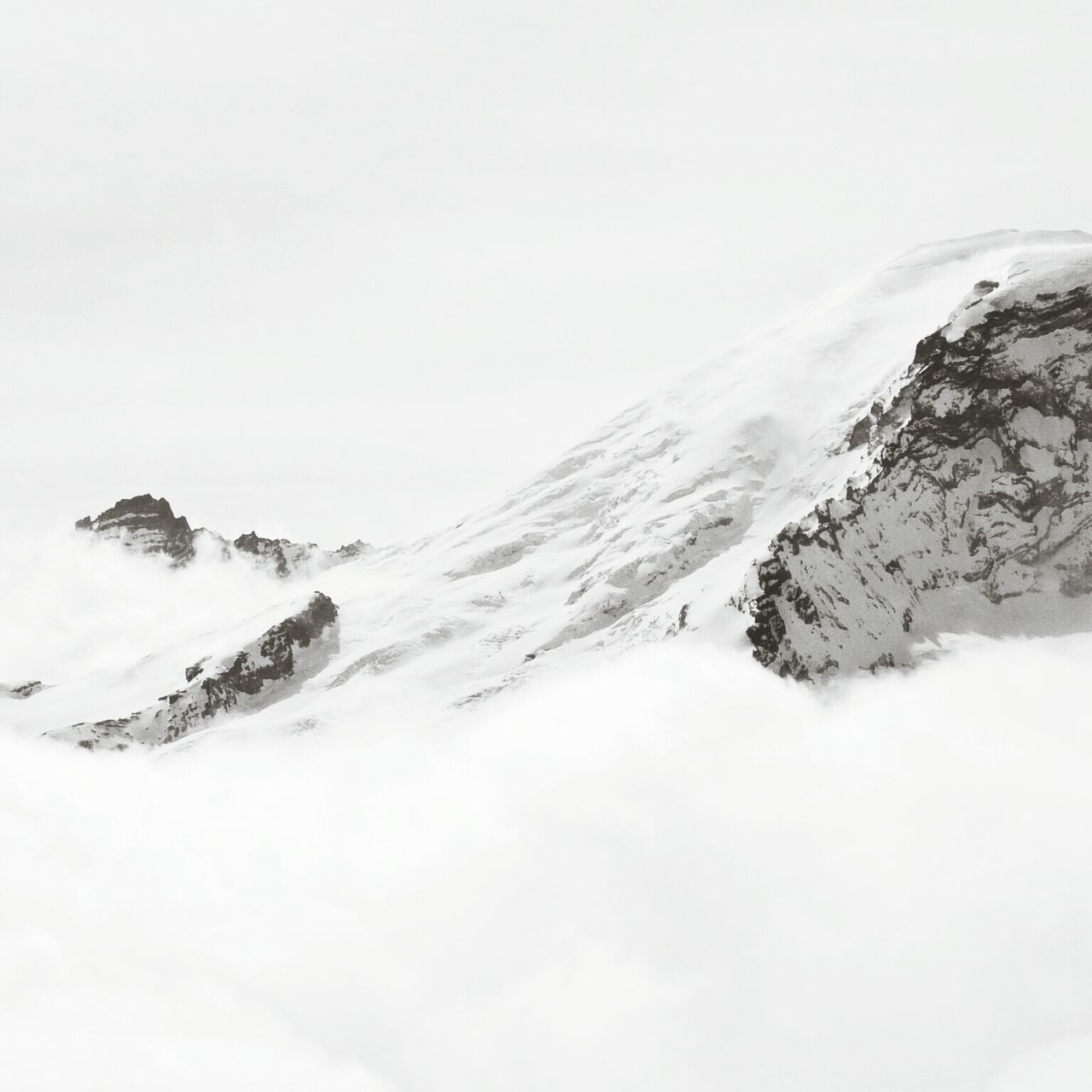 View of snow covered landscape against clear sky