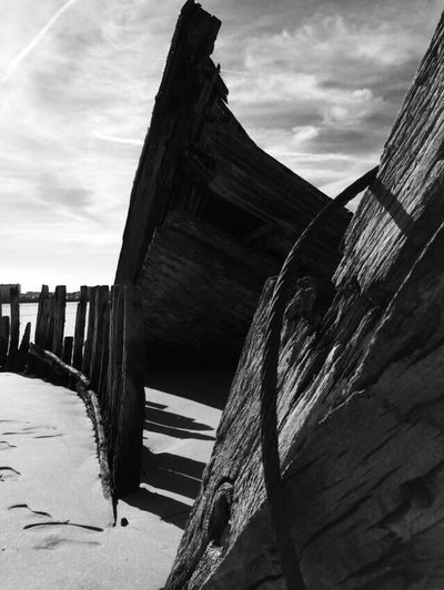 Boat cemetery Boat Wood - Material Sky Built Structure Architecture Cloud - Sky Beach Day No People Sea Outdoors Building Exterior Tranquility Horizon Over Water Nature