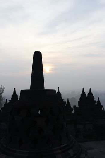 Silhouette Borobudur Temple with the mysteries forest surrounding during sunrise, Yogyakarta, Indonesia Ancient Borobudur Temple Java Yogyakarta Ancient Ancient Civilization Architecture Buddhism Built Structure Cloud - Sky Dawn Fog Forest History Mount Merapi Nature No People Place Of Worship Religion Religious Architecture Sky Spirituality Sunrise Sunset