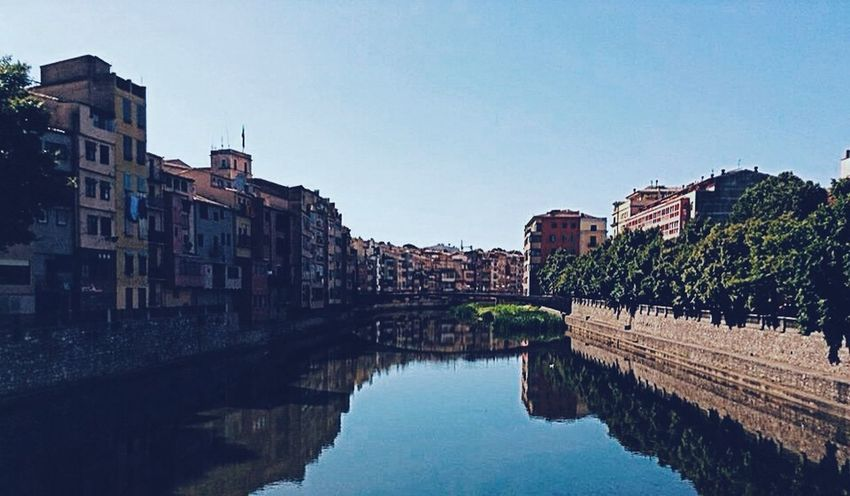 Girona SPAIN Bridge House By The Water It is life, I think, to watch the water. A man can learn so many things
