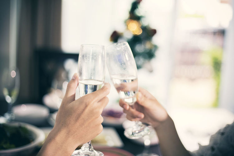 Alcohol Celebration Celebratory Toast Champagne Champagne Flute Close-up Drink Drinking Glass Focus On Foreground Food And Drink Holding Human Body Part Human Hand Indoors  Leisure Activity Lifestyles Men Party - Social Event Real People Togetherness Two People Wedding Wine Wineglass Women